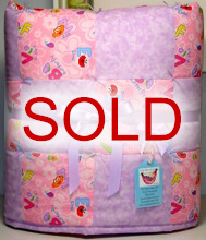 Adorable Sesame Street Baby Girl Quilt